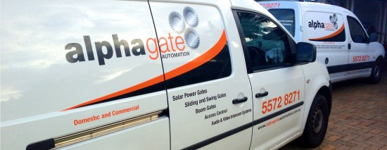 two parked up alpha gate automation service vans