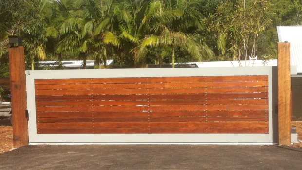 Aluminium frame sliding gate with natural wood cladding