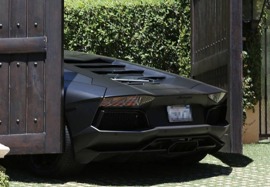 kanye's lamborghini aventador scraping paint on kim kardashian's automatic gate