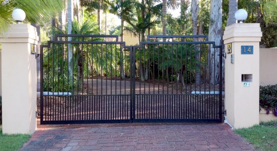 black electric swing gates across a driveway
