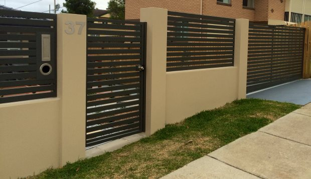 Sliding gate with pedestrian access